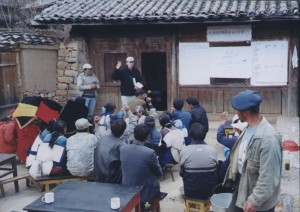 image of Graham Bulloc faciltating group discussion in Chinese village